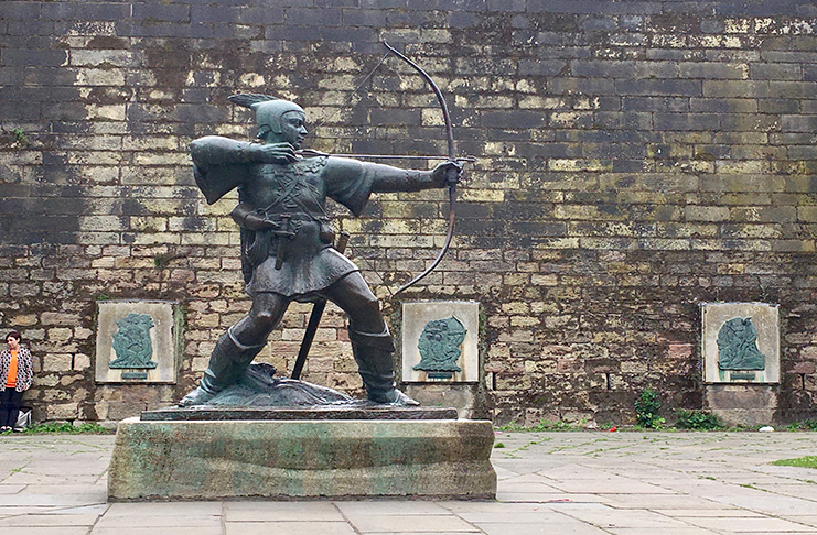 A statue of Robin Hood outside 1000-year-old Nottingham Castle.