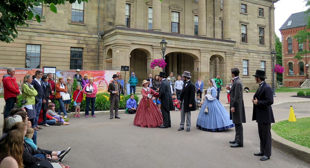 Province House History comes alive in Charlottetown's historic district with a troupe of costumed bilingual Canadians portraying the Fathers and Ladies of the Confederation, providing a glimpse into the historical and cultural context of the Charlottetown Conference. The scene here show their debate on the benefits of a Confederation.
