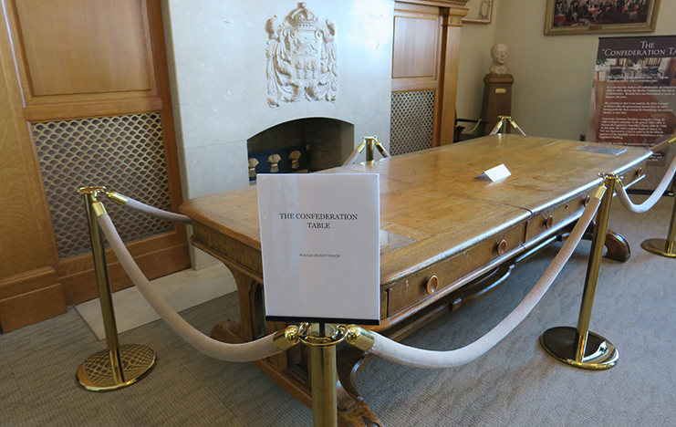 This golden-hued oak table was used by the Fathers of Confederation at the Quebec Conference of October 1864, one month after the initial meeting in Charlottetown. The 72 resolutions regarding the constitutional provisions of Canada's confederation, which laid the foundation for Canada's democratic system of government, was negotiated around this table. It was a witness to so many aspects of the coming together of Confederation in both eastern and western Canada. The Confederation Table was brought to Saskatchewan sometime between 1883 and 1892 by the Honourable Edgar Dewdney, Lieutenant Governor of the North-West Territories, and has been kept inside the Legislative Library in Regina since 1914.