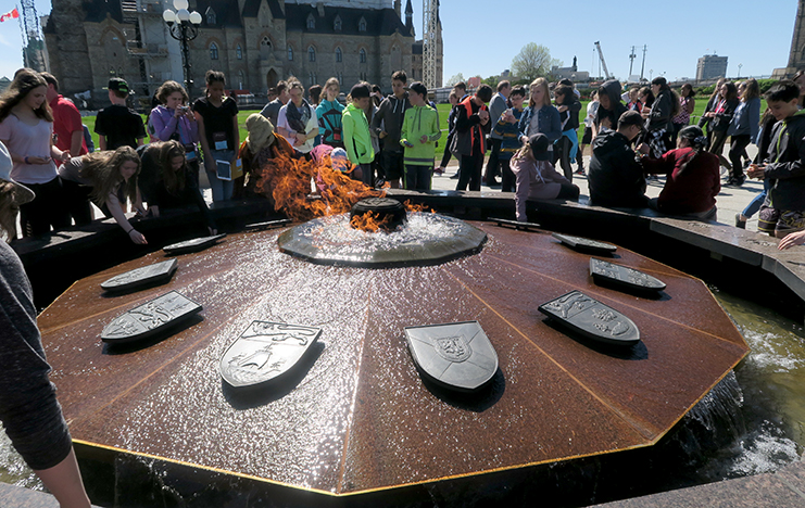 The Centennial Flame on Parliament Hill has been burning for 50 years. This flame was lighted by Prime Minister Lester B. Pearson in 1967 to mark the first 100 years of Confederation. The coats-of-arms of the provinces and territories encircle the flame with the dates they joined Confederation carved on the coping of the fountain.