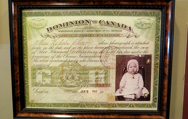 "The Canadian government implemented an Act to Restrict and Regulate Chinese Immigration to Canada in 1885. The Chinese Immigration Act of 1900 raised the entry head tax from $50 to $100 per person including infant. By 1903, it was raised again to $500 as seen here on the certificate, which was a staggering amount in those days. The Federal government continued to collect the head tax until Chinese immigration was altogether halted with the passing of the ""Exclusion Act"" of 1923. In total $23 million was collected which is equivalent to $1 billion today. European immigrants did not have to pay fees or tax, and were given many incentives to come, including land for development."