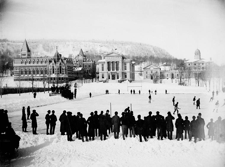 A hockey game on campus in 1884, just seven years after McGill students wrote the then-new game's first rule book, with the Arts Building, Redpath Museum, and Morrice Hall (then the Presbyterian College) visible. Photo by Alexander Henderson.