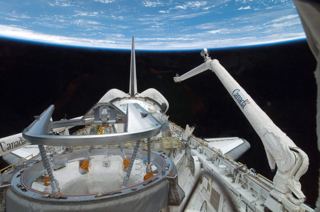 The Canadarm on the Atlantis Space Shuttle. Photo by NASA