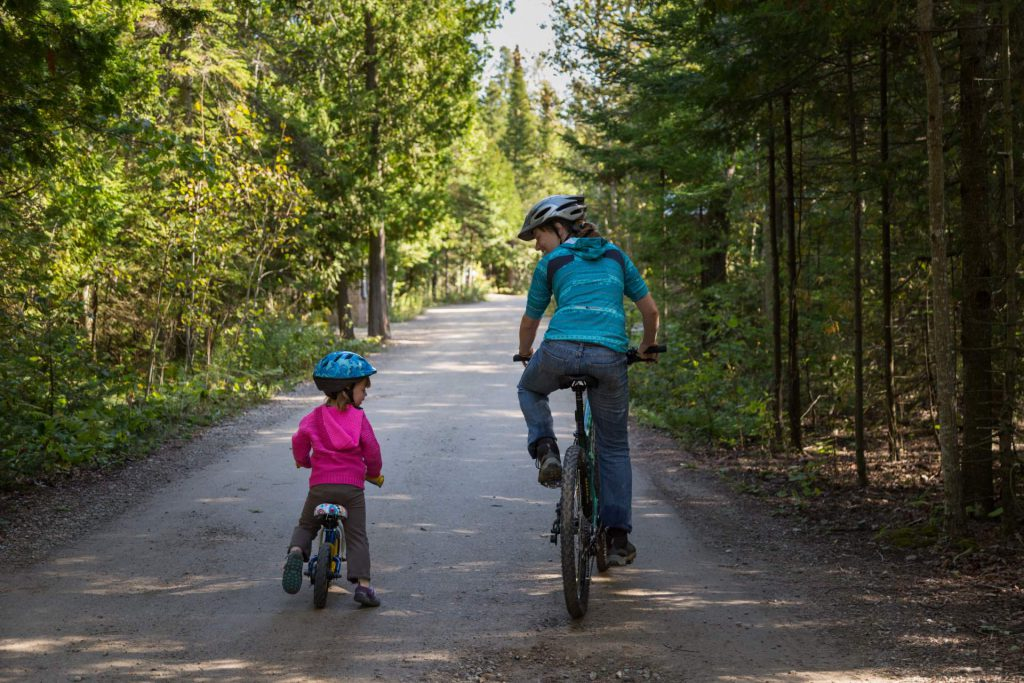 Mother and daughter cycling, Bruce Peninsula National Park